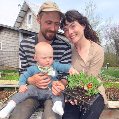 Carina Phillips and Byron Petrie with their son, Remy.
